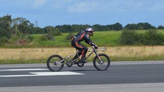 Neil Campbell being set off for his cycling speed record