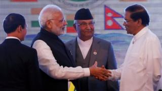 Indian Prime Minister Narendra Modi (second left) shakes hands with Sri Lankan President Maithripala Sirisena (right) in the presence of Nepali Prime Minister Khadga Prasad Sharma Oli