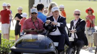 Donald Trump drives himself around his Doral golf course