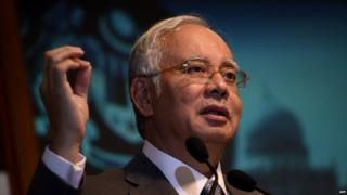Malaysian Prime Minister Najib Razak gestures while addressing an event for new government interns at the Prime Minister's office in Putrajaya on 8 July 2015