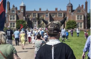 The procession heads to Kentwell Hall for the play