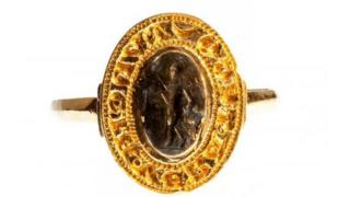 A gold seal ring