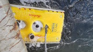 Remotely operated vehicle emerges from beneath the Corran Ferry