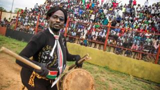 A man entertains the crowd before the first round African Nations Championship qualifying football match between South Sudan and Somalia at Juba Football Stadium on April 30, 2017