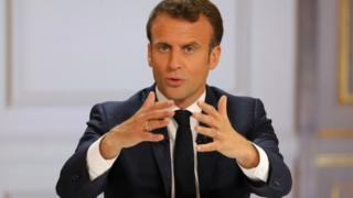 Emmanuel Macron speaking at the Elysee Palace on April 25