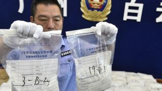 The police officer shows the seized crystal process on May 18, 2016 in Guangzhou, Guangdong province, China.