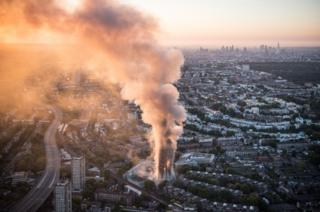 Aerial view of smoke and flames rising from Grenfell Tower block in west London, 14 June 2017