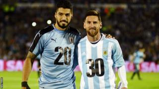 Uruguay's Luis Suarez and Barcelona team-mate Lionel Messi of Argentina pose for photos in special kits promoting the 2030 bid