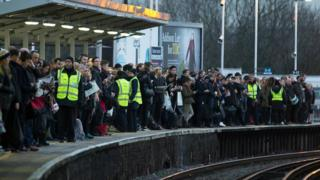 commuters waiting at Clapham junction on one of the southern strike days