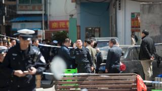 Police cordon off an area outside a primary school where 10 children were stabbed on Monday, in Haikou, Hainan province, February 29, 2016