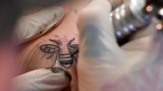 Tattoo of a bee