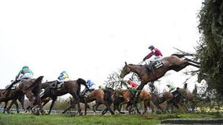 David Mullins riding Rule The World clears a jump on the way to winning the Crabbie's Grand National steeplechase at Aintree Racecourse on April 9, 2016