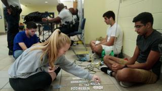 Florida residents bunk at a shelter in Daytona Beach