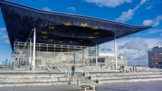 The Senedd with a European flag projected onto its roof