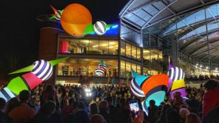 French troubadours Picto Facto bring the Love Light festival parade to Norwich's Forum building