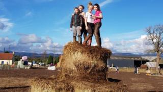 children on hay bales at Arnprior Pumpkin Patch in Stirling