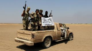 Fighters from Jabhat Fateh al-Sham in a pick-up truck in Idlib, Syria, on 1 August 2016