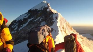 Climbers make their way to the summit of Everest,