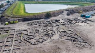Aerial view of the excavation site reveals an organized grid system of the ancient city.
