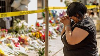 A woman weeps outside church