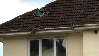 Roof of house with hole in it