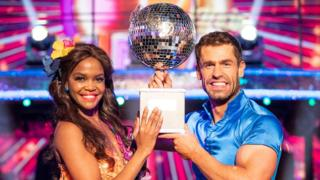 Oti Mabuse and Kelvin Fletcher with the glitterball trophy