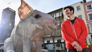Alex Rinsler with piglet