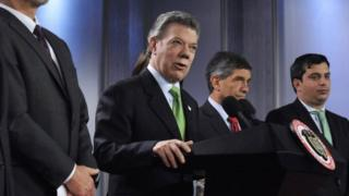 Handout picture provided by Colombian Presidency showing Colombian President, Juan Manuel Santos (C), next to his collaborators during an event at Casa de Narino presidential palace in Bogota, Colombia, on 20 November 2015.