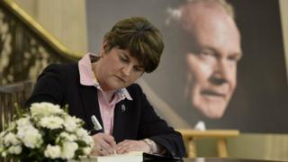 Arlene Foster signs the book of condolence