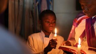 Worshipers pray during Easter prayers at a Legio Maria African Mission Church in Kibera slum in Nairobi Kenya, April 1, 2018.