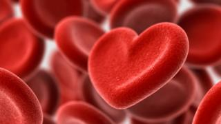 red blood cells and one heart-shaped one