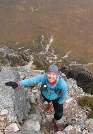 Carol climbing Curved Ridge