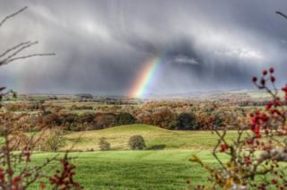 A double rainbow over fields