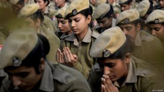 Indian police women constables meditate during a yoga laughing therapy session on the first day of the New Year in Jalandhar on January 1, 2018.