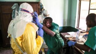 health workers dey check Ebola patients