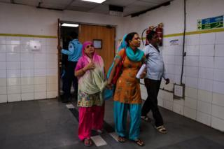 Indian patients walk in the fever ward at the Lok Nayak Hospital in New Delhi on September 2, 2016.
