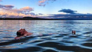 Man floating in water