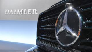 Mercedes-Benz star in front of automobile