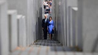 The Duke and Duchess of Cambridge walk through the Memorial to the Murdered Jews of Europe