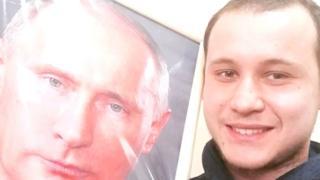 Артем Галанов с портретом Путина