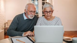 Couple looking at a computer and finances