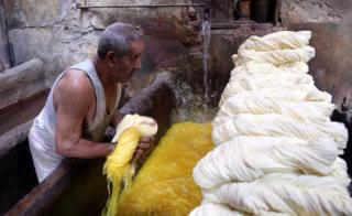 "Salama, 76, owner of the tannery, dyes white yarn rolls inside his tannery in Cairo, Egypt, 07 November 2017. Salama started working when he was seven years old during the reign of King Farouk over Egypt because, according to him, the police used to arrest unemployed males of all ages. Now, after almost 70 years, Salama""s tannery is the only one left in the old part of Cairo. The yarn produced is used for shoe laces, mattresses upholstery, ballet dance outfits, and suits."
