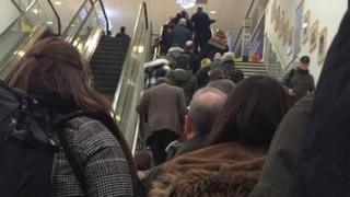 Passenger queues stretching down steps on Thursday night