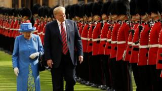 The Queen walks alongsidDonald Trump as the US President inspects the guard of honour during a welcome ceremony at Windsor Castle on 13 July 2018