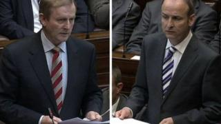 Acting Taoiseach (Prime Minister) Enda Kenny leads the Fine Gael party while Micheál Martin (right) is the leader of the largest opposition party, Fianna Fáil