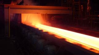 Molten steel going through a mill
