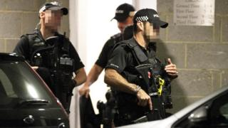 Armed officers at the scene of a stabbing