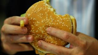 (file Getty photo) Western Australia police have arrested a naked man accused of rifling through a car and stealing a fast food burger.