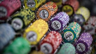 Casino chips are displayed at the Global Gaming Expo Asia in the world's biggest gambling hub of Macau.