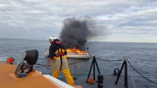 Yacht on fire in Poole Harbour